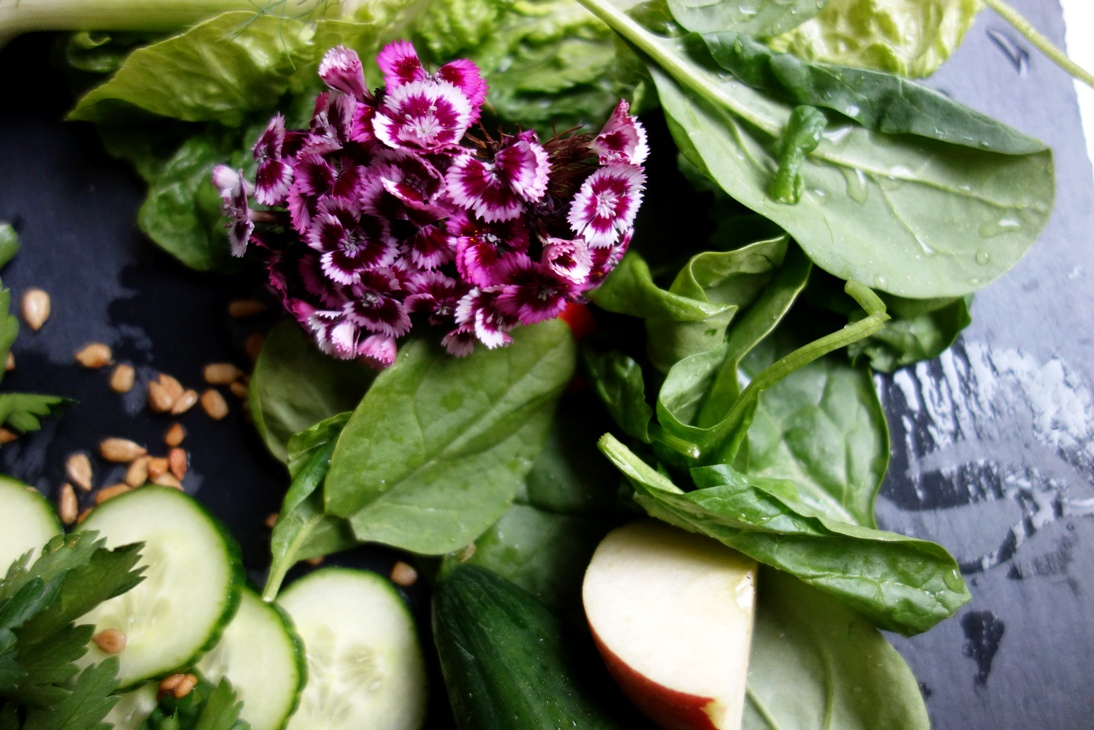 Ingredients with flowers for green juice