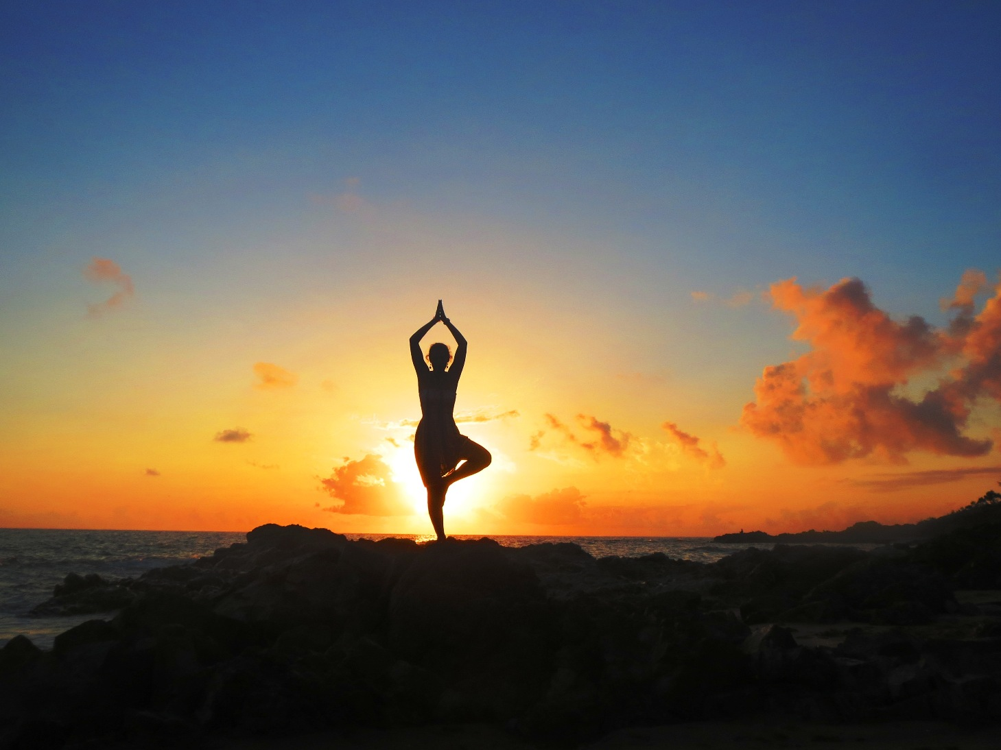 Yoga Tree Pose on beach