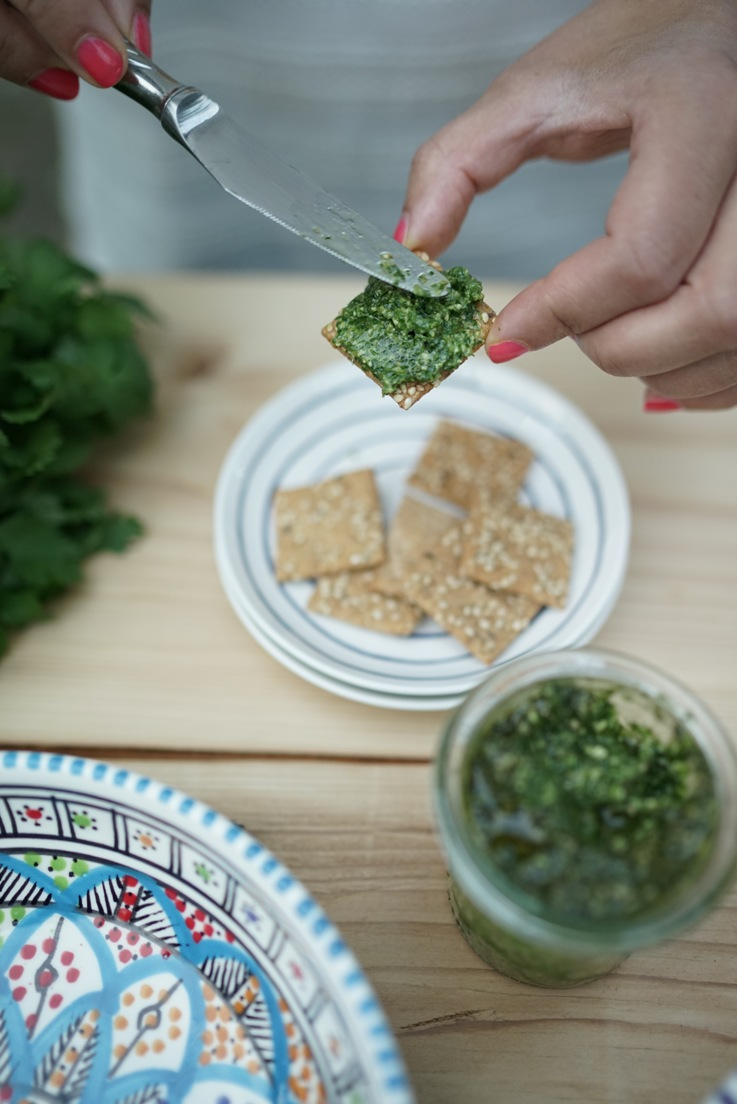 Spreading coriander pesto