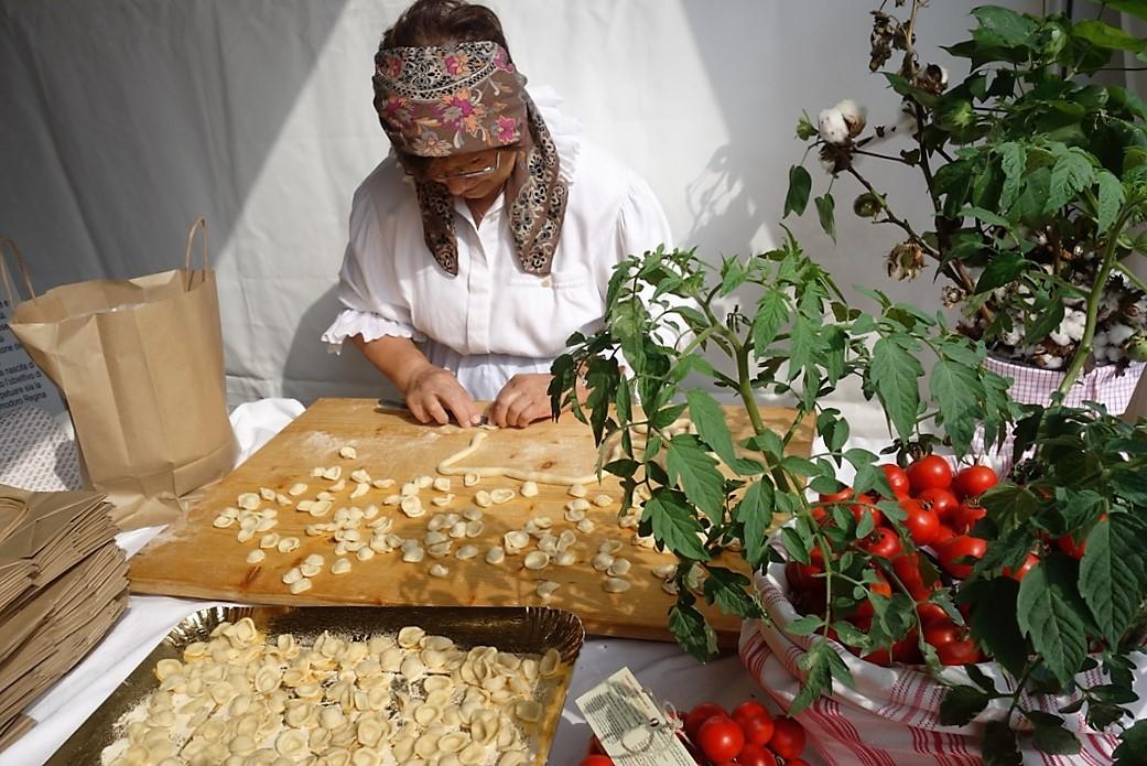 Older woman makes pasta